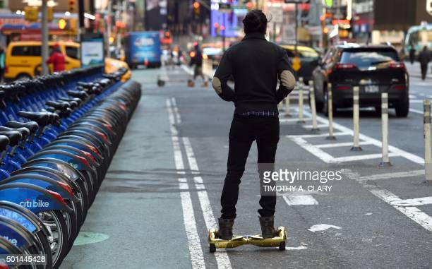 Whizboard Store manager 'Mor Loud' demonstrates the Hoverboard on Broadway in Times Square in New York on December 15 2015 The hot item on many...