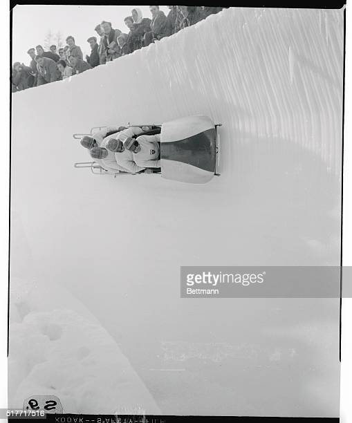 Whizzing right under the onlookers' noses Switzerland's number one bobsled team climbs high on the ice bank to come in a close second to the Swiss...
