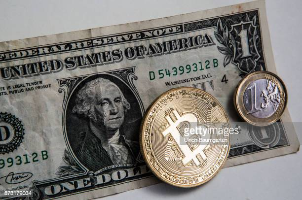Who against who or all together in the world currency market The photo shows a one dollar banknote a one euro coin and a bitcoin