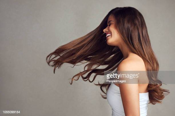who could say no to having gorgeous hair - one young woman only stock pictures, royalty-free photos & images