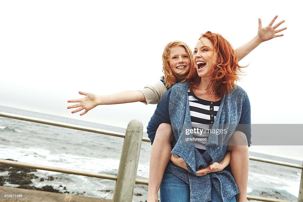 Who doesn't like a good piggyback ride : Stock Photo