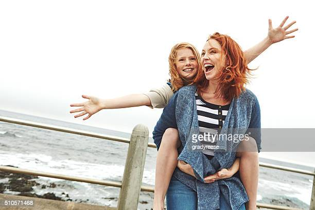 who doesn't like a good piggyback ride - redhead girl stock photos and pictures