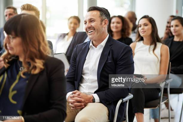 who doesn't love an entertaining presentation? - attending stock pictures, royalty-free photos & images