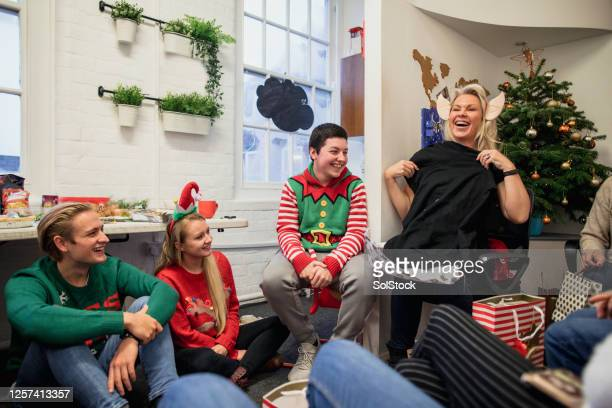 who is my secret santa? - ugly christmas sweater party stock pictures, royalty-free photos & images