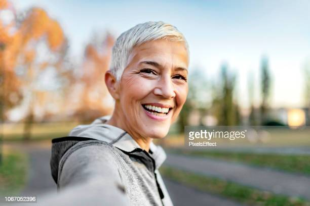 who said selfies are just for the youth? - one mature woman only stock pictures, royalty-free photos & images