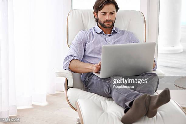 who says you can't work with your feet up? - reclining chair stock photos and pictures
