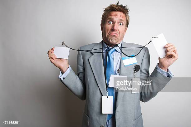 Who The Heck Knows? Confused Businessman Holding Many Name Tags