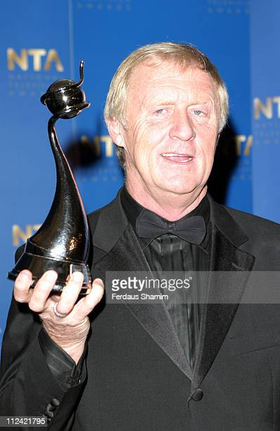 Who Wants To Be A Millionaire's Chris Tarrant with his 2005 National Television Award for Best Quiz Programme