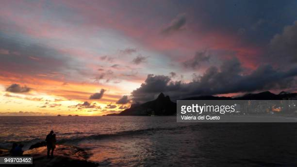 who watches it is part of the spectacle at sunset in ipanema - sem fim... valéria del cueto stock pictures, royalty-free photos & images