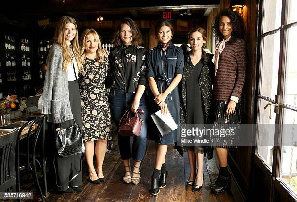 Who What Wear CoFounders Hillary Kerr and Katherine Power pose with models at the Who What Wear Collection x Target LA Influencer luncheon at AOC on...