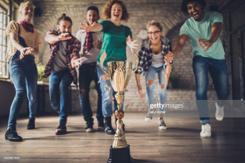 Who will get first to the trophy? : Stock Photo