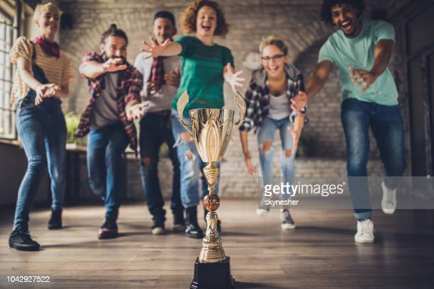 who will get first to the trophy? - award stock pictures, royalty-free photos & images