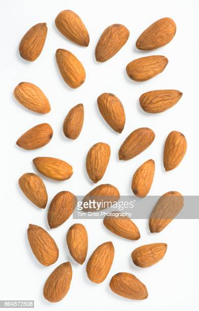 whole almonds - almond stock pictures, royalty-free photos & images