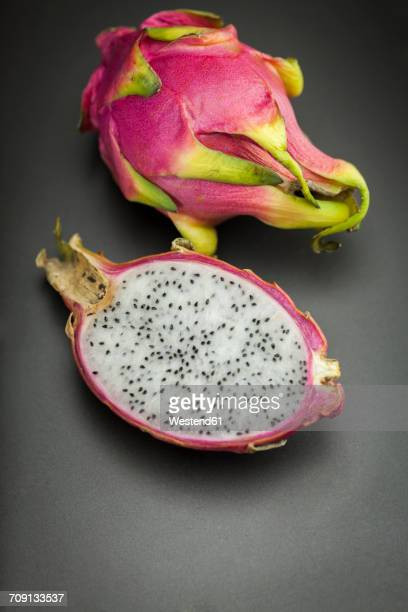 whole and a half dragon fruit - dragon fruit stock pictures, royalty-free photos & images