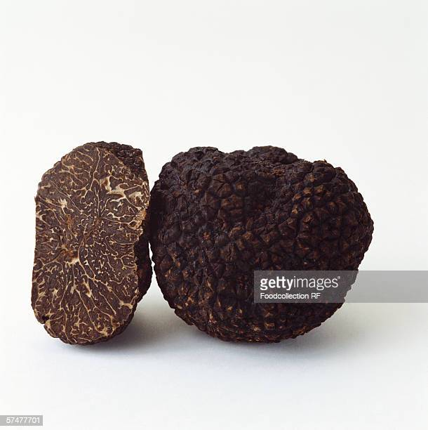 Whole and half black truffle from Perigord