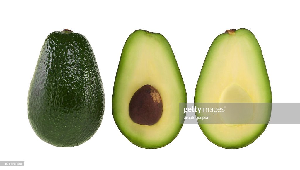 A whole and halved avocado on white : Stock Photo