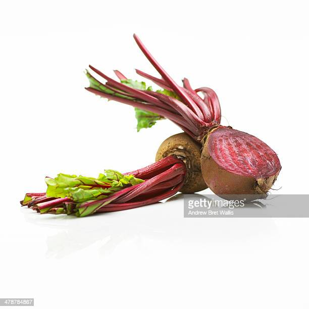 Whole and halved fresh organic beetroot