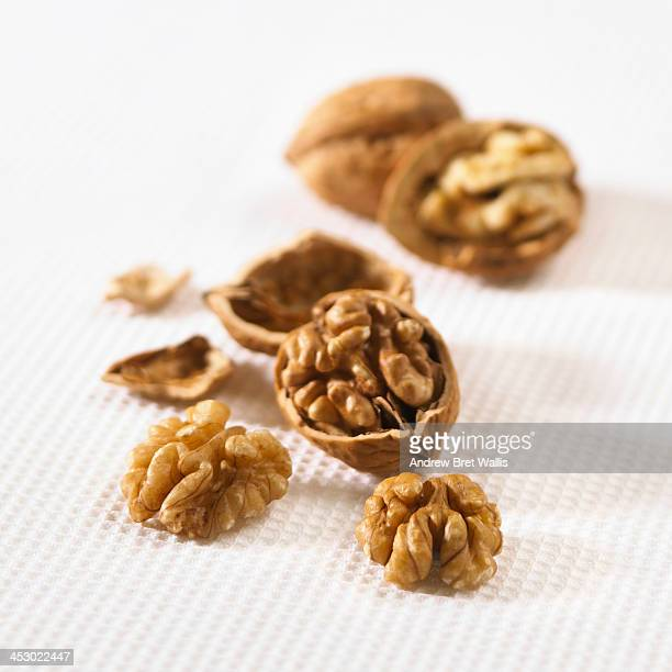 Whole and halved fresh walnuts