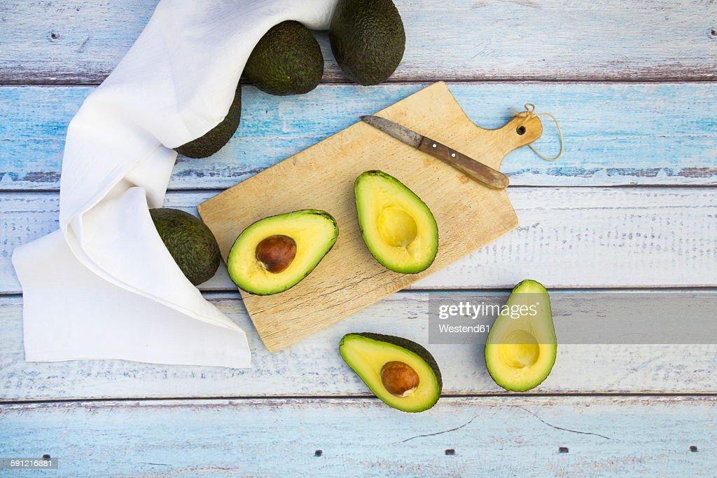 Whole and sliced avocado : Stock Photo