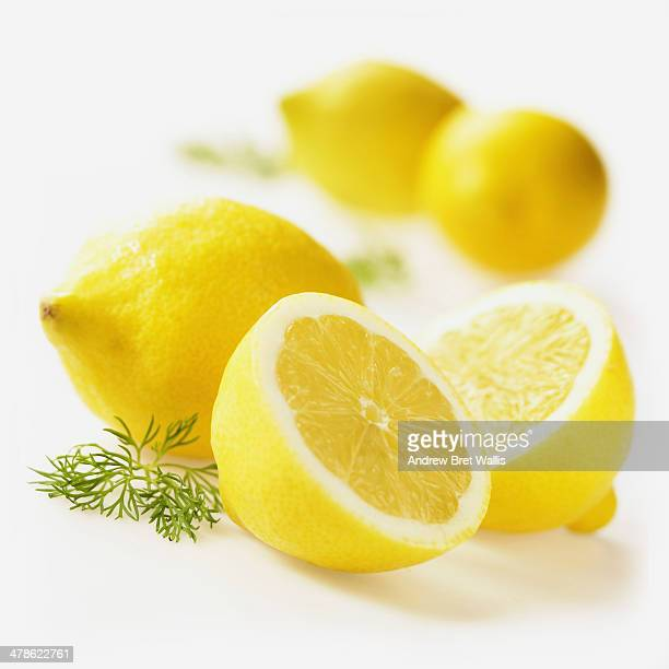 Whole and sliced lemons with dill leaf