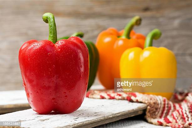 Whole Bell Peppers on Wood