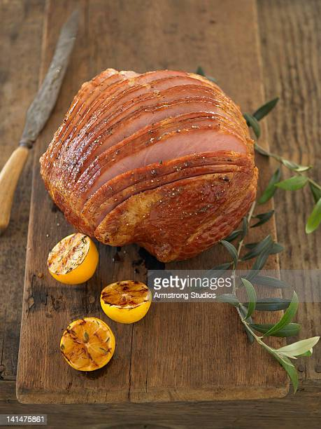 Whole carved ham on cutting board