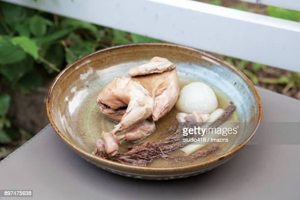 whole chicken soup - samgyetang stock photos and pictures