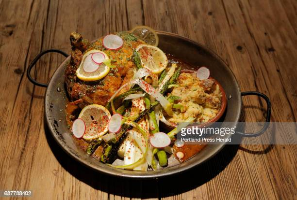 A whole chicken steamed then fried with Meyer lemonhoney mustard served with biscuit bread pudding and a spring asparagus salad with avocado oil and...