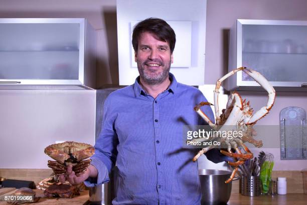 Whole cooked spider grab, portrait of man