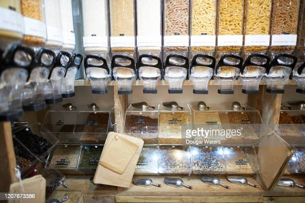 whole foods dispensers in a zero waste refill store. - health food shop stock pictures, royalty-free photos & images