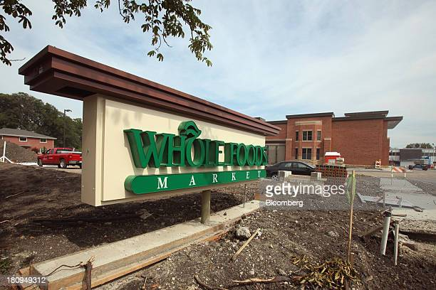 Whole Foods Market Inc. Signage sits outside a new store under construction in Park Ridge, Illinois, U.S., on Tuesday, Sept. 17, 2013. Whole Foods is...