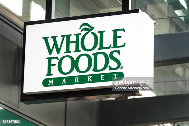 Whole Foods sign hanging on a store entrance in Yonge Street The company was recently acquired by Amazon