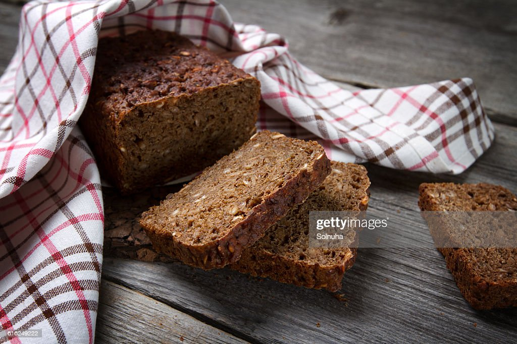 Whole grain bread on old table : Stock Photo