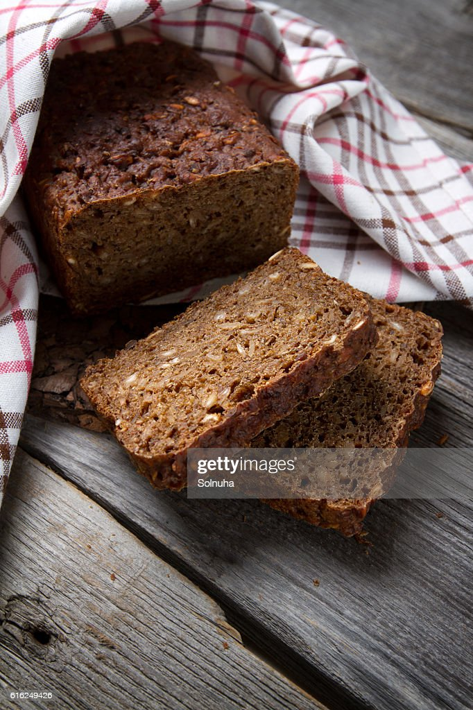 Whole grain bread on old table : Stock-Foto