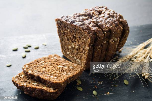 whole grain rye bread with seeds - パン ストックフォトと画像