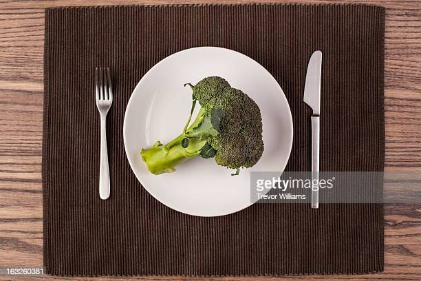 A whole head of broccoli on a plate