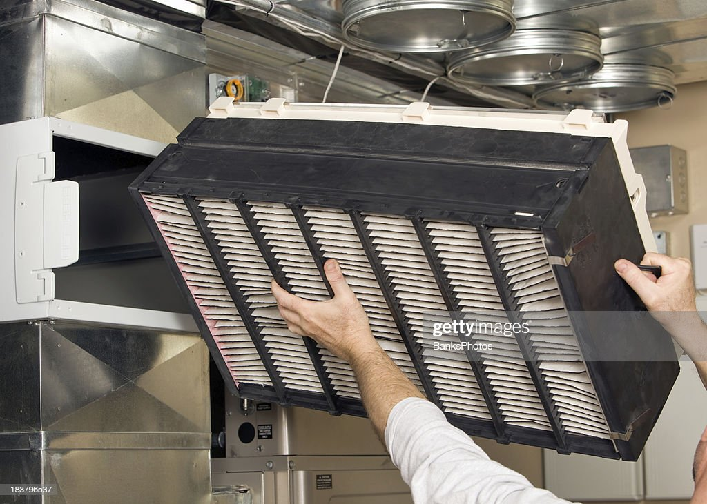 Whole House Air Cleaner Filter Installation : Stock Photo
