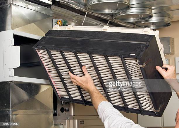whole house air cleaner filter installation - belichting stockfoto's en -beelden