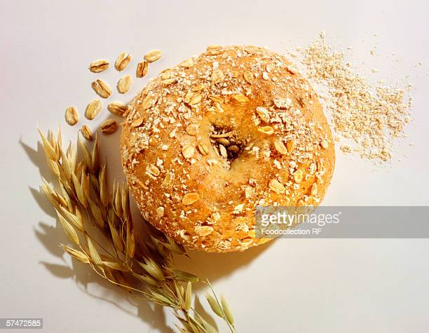 whole meal bagel - rolled oats stock photos and pictures
