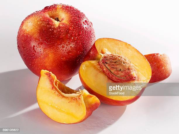 A whole nectarine and one cut into pieces
