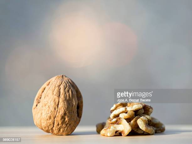 Whole peeled walnut and walnut pieces