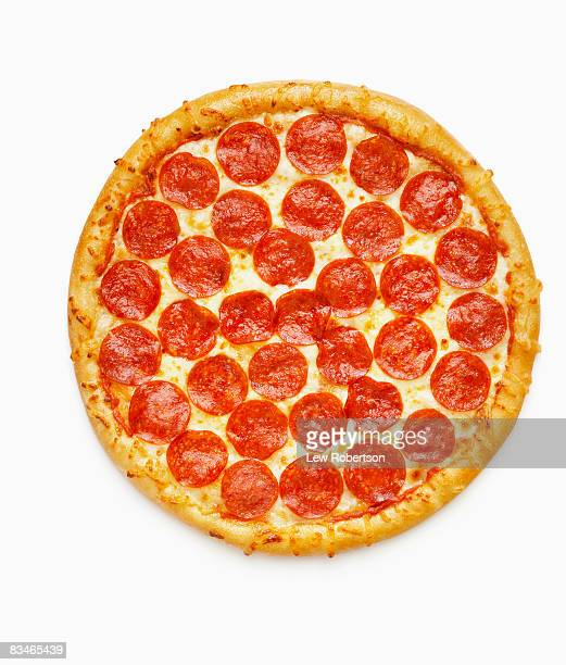 whole pepperoni pizza - pepperoni pizza stock photos and pictures