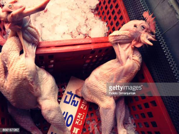 A whole raw chicken meat for sale in Seoul, South Korea traditional market