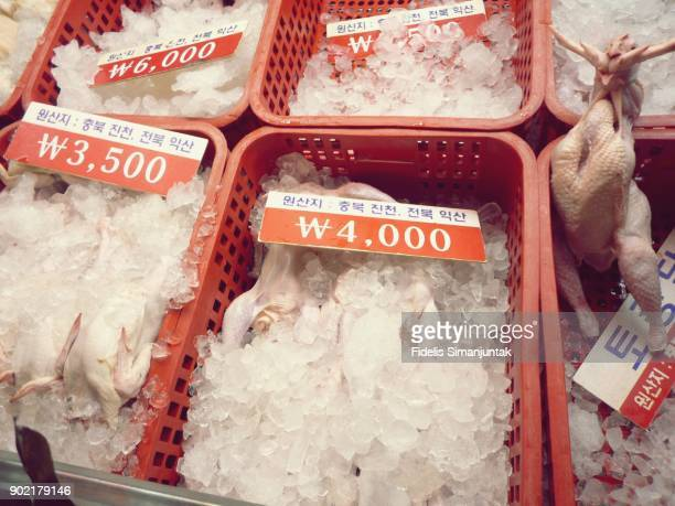A whole raw chicken meat in ice box for sale in Seoul, South Korea traditional market