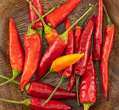 whole red chili pepper pods wooden