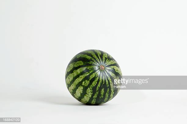 a whole ripe watermelon, studio shot - watermelon stock pictures, royalty-free photos & images