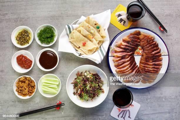 WASHINGTON DC Whole Roast Duck with Flour Tortillas Duck Confit Salad Seasoned Hoisin Sauce Hot Sauce Cucumbers and Scallion at Spoken English a...