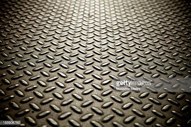 Whole screen view of metal diamond plate flooring.