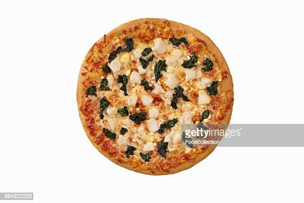 Whole Spinach and Feta Cheese Pizza on a White Background; From Above