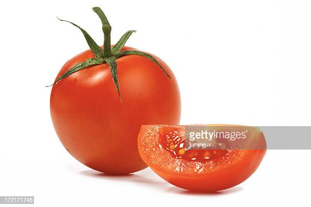 A whole tomato and a sliced segment